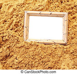 Vacations background - wooden frame on sand