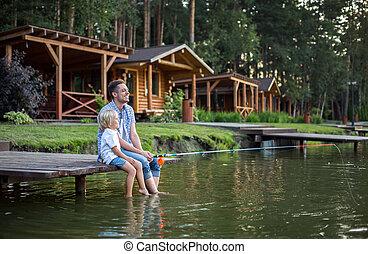 Vacations - Dad and son fishing at lake