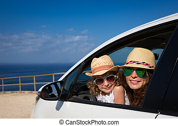 Vacations - Happy family in car against sea and sky. Summer...