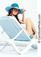 Vacations - Portrait of a young smiling girl sitting in...