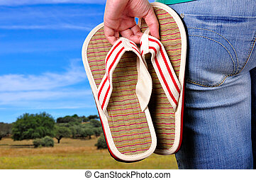 Vacations Start - Girl holding sandals on the first day of ...