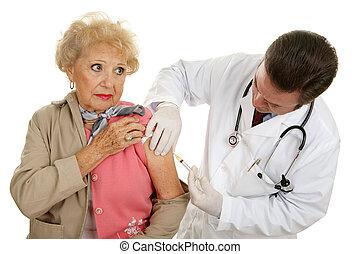 Vaccine - Preventive Medicine - Senior woman getting a...