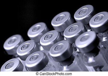 glass vaccine phials on black