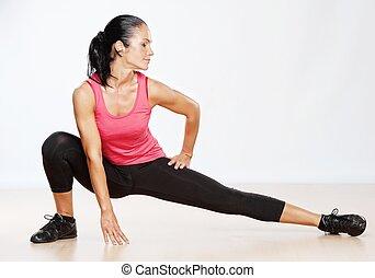 vacker, atlet, kvinna, gör, fitness, exercise.