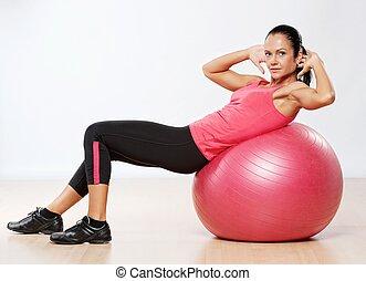 vacker, atlet, kvinna, med, a, fitness, ball.