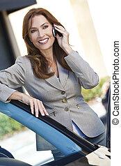 vacker kvinna, henne, affärskvinna, mobiltelefon, stående, eller