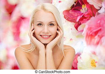 vacker kvinna, henne, ansikte, rörande, skinn