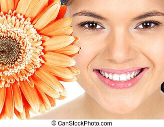 vacker kvinna, le, med, flower.