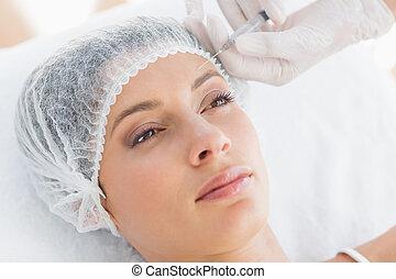 vacker kvinna, mottagande, botox, inj
