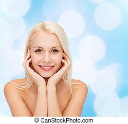 vacker kvinna, rörande, henne, ansikte, skinn