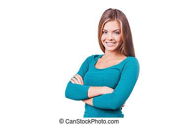 vacker, stående, hålla, kvinna, beauty., isolerat, ungt se, tillitsfull, medan, kamera, korsat beväpnar, vit