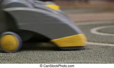 vacuum cleaner cleans carpet