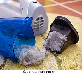 Vacuum cleaner full of dust and hair clots - Close up of...