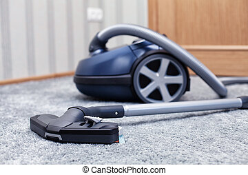 Vacuum cleaner - The new vacuum cleaner lies in a room