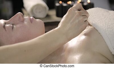 vacuum face and decolletage massage, beautician does massage...