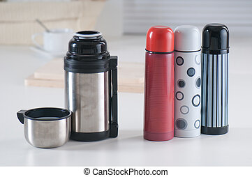 Vacuum flasks - Set of vacuum flasks on a kitchen table