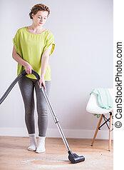 Vacuuming the room