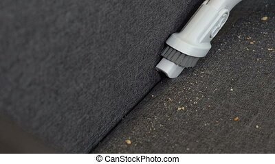 Vacuuming the sofa in the room - Vacuuming a sofa dirty from...