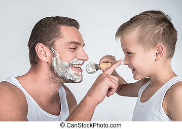 vader en zoon, het scheren, samen