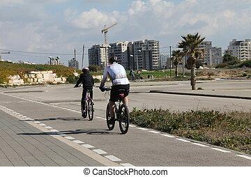 vader en zoon, paardrijden, op, bicycles