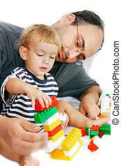 vader en zoon, spelend, met, gebouw stel