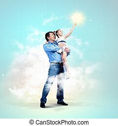 vader, holding, handen, dochter