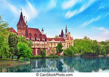 Vajdahunyad Castle (Hungarian-Vajdahunyad vara) with lake...