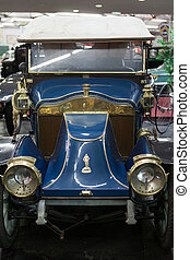 The grill and headlamps of an expensive vintage classic car....