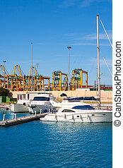Valencia city Marina and port cranes in background