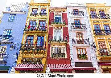 Valencia colorful facades in front Mercado Central at Spain...