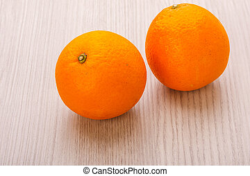 navel orange - valencia orange or navel orange on wood...