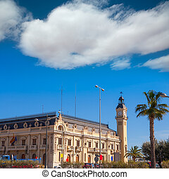 Valencia Port building with tower and palm tree in...
