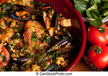 Terracotta pan with Valencian typical paella.
