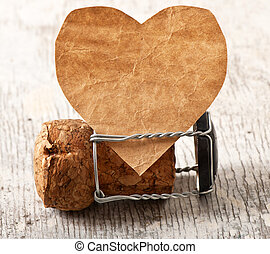 valentine and wine stopper on the old wooden background