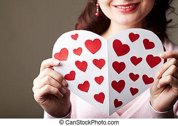 Valentine card - Close-up of female hands holding valentine ...