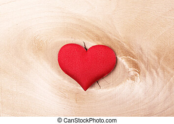 red heart on a light wooden background