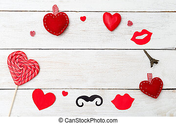 Valentine card with red heart on white wooden background. Copy space