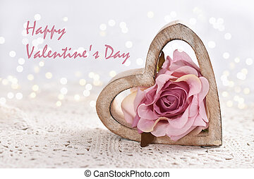Valentine card with wooden heart and pink rose