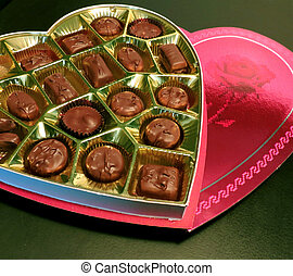 Valentine Chocolates - A heart-shaped box of chocolates for...