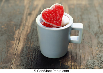 Valentine composition with hearts in a blue cup on wooden...