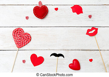Valentine concept with red heart  on wooden background. Copy space