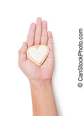 Valentine cookie heart in hand isolated on white
