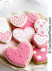 Valentine cookies - Heart shaped cookies with pink and white...