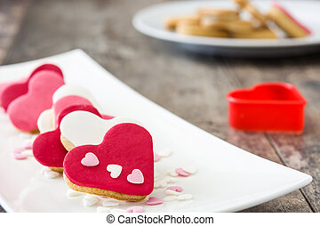 Valentine cookies with heart shape on wooden background