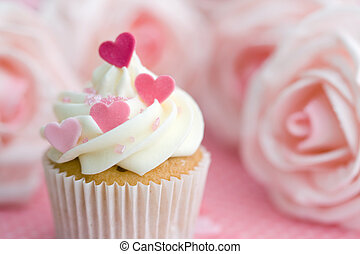 Valentine cupcake - Cupcake decorated with frosting and pink...