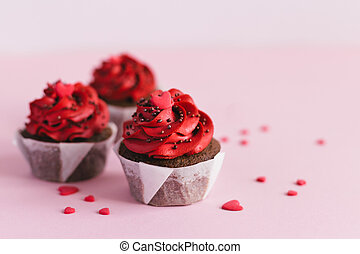 Valentine cupcakes, decorated with sweet hearts on pink pastel background.