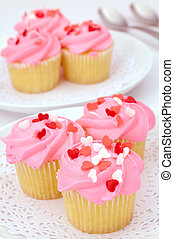 Valentine cupcakes - Small pink cupcakes decorated with...