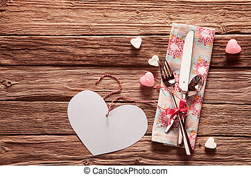 Valentine cutlery with a heart an copyspace