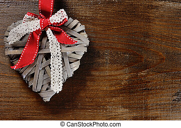 valentine day concept - heart on wooden background