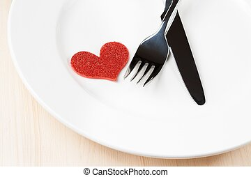 valentine day dinner to restaurant on wood background